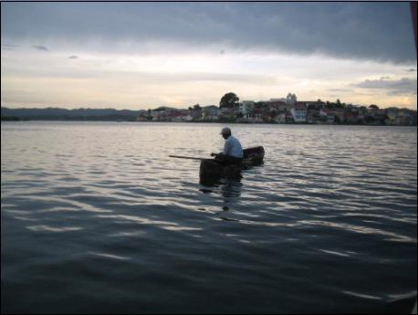 Fisherman on Lake Peten Itza, Flores in background