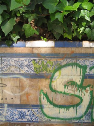 Graffitied tiles in Seville